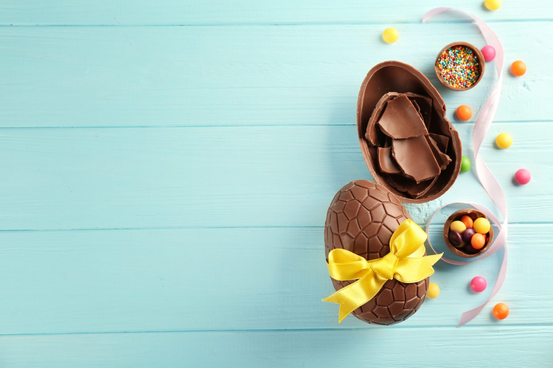 Photo of Chocolate Easter Eggs on turquoise blue background